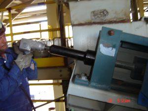 Technician servicing a conveyor component