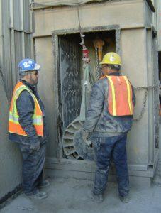 Technicians servicing a conveyor